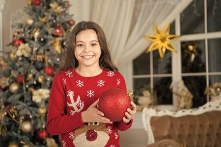 Christmas composition. little child girl likes xmas present. Happy new year. small happy girl at christmas. Christmas. Kid enjoy the holiday. The morning before Xmas. New year holiday Stockfoto