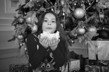 Happy new year. Christmas. Kid enjoy the holiday. small happy girl at christmas. The morning before Xmas. New year holiday. little child girl likes xmas present. Colorful fun. doing magic
