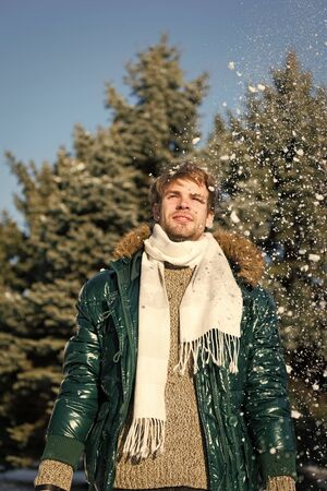 Vacation and traveling in winter. Snowy weather. Trendy winter coat. Man. It is cold outside. Forest in snow. Fresh air. man on winter holidays. Winter fashion. Warm clothes. Enjoying good morning Foto de archivo - 131300926