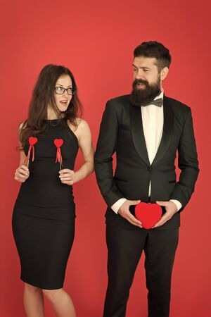 symbol of love and sexuality. Man holding heart on piquantly organ. fertility. sex shop. sex industry, formal couple. love and sex. sexy couple in love. tuxedo man and woman. valentines day Banque d'images - 131301327