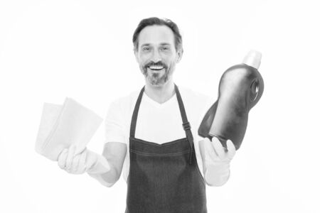 Rub to shine. Everything should be perfect. Cleaning service and household duty. Man in rubber gloves hold bottle liquid soap chemical cleaning agent. Bearded guy cleaning home. Cleaning home concept