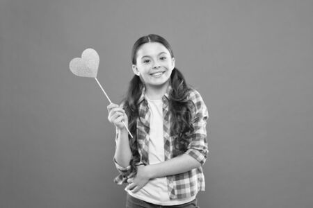 Personal attitude. I definitely like this. Vote for love. Girl little child hold heart symbol on stick. Like and support. Valentines day. Fall in love. Love will save the world. Kid promoting love Stock fotó