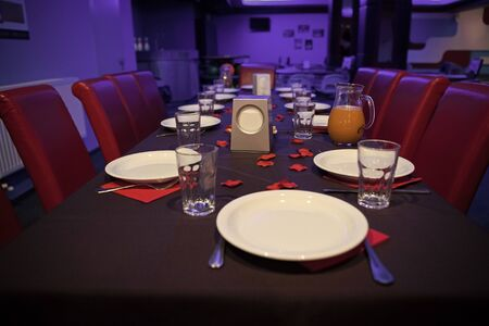 Restaurant table served with plates and glasses.Table prepared for party in cafe or restaurant. Catering and celebration concept. Celebrate birthday in restaurant. Family holiday or corporate. Stockfoto