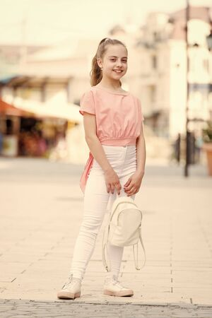 Kid long hair enjoy walk sunny day. Summer holidays. Charming stylish fashionable girl. Little child enjoy walk. Happy day. Enjoy being teen. Weekend walk. Girl carefree child. Only fun on my mind