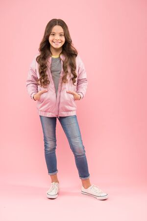 Fashion is her life. Autumn look of small fashion model. Happy girl in cozy fashion outfit on pink background. Cold weather fashion for kids. Gorgeous and beautiful Stock Photo