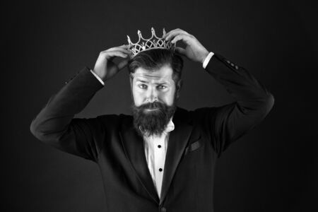 Sense of self importance. Big boss. King crown. Egoist concept. Businessman in tailored tuxedo and crown. Very important person. Important guest luxury party. Top manager. Important person award