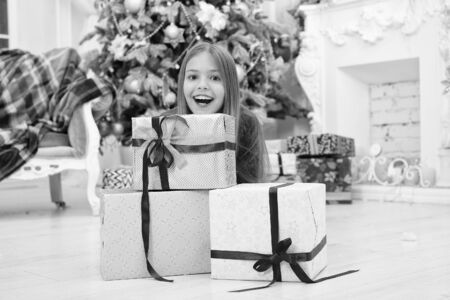 Child enjoy the holiday. Decorate your Christmas with joy. Christmas tree and presents. Happy new year. Winter. xmas online shopping. Family holiday. The morning before Xmas. Little girl