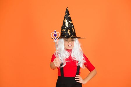 Wizard with stick. Having fun with magic. Little child in witch costume. Halloween party. Small girl in black witch hat. Autumn holiday. Join celebration. Magical spell. Small witch with white hair Banco de Imagens