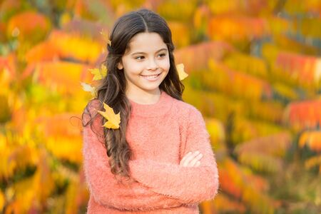 The mellow autumn mood. Happy small child in good mood outdoors. Little child play on fresh air on autumn day. Cheerful mood. Setting fall mood Stock Photo