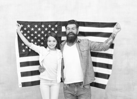 How do americans celebrate independence day. Father and daughter with USA flag. Patriotic family. Independence day is chance for family members to reunite and relax. Independence day public holiday