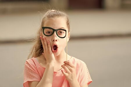 Pamper your skin with natural treats. Small child with healthy skin and funny look through prop glasses. Cute little girl with soft baby skin on surprised face. Childrens skin care cosmetics Banco de Imagens