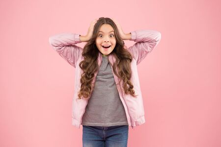 Whoa. Autumn surprise. Surprised kid on pink background. Surprised child in fashion autumn style. Small girl wear long brunette hair with surprised look. Surprised and shocked