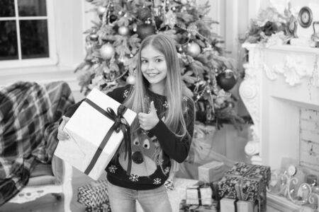 Merry Christmas. xmas online shopping. Family holiday. Christmas tree and presents. Happy new year. Winter. The morning before Xmas. Little girl. Child enjoy the holiday