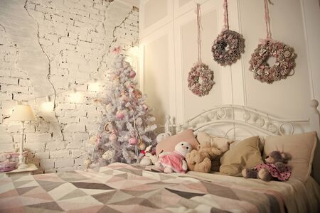 Merry Christmas and Happy Holidays. Christmas composition. Happy new year. Christmas. Beautiful decorated room with tree and toys. The morning before Xmas. New year holiday. Christmas interior