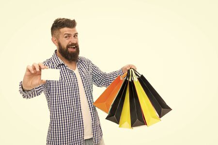 Discount is applied here. Bearded man smiling with discount card and paperbags isolated on white. Happy hipster shopping with price discount. Going to discount store, copy space