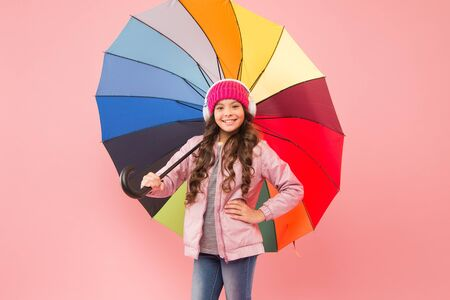 Accessory in case it rains. Small child enjoy music under colorful umbrella rain accessory. Little girl in coat with fashion accessory for rainy autumn season. The perfect accessory to keep her dry Stock fotó