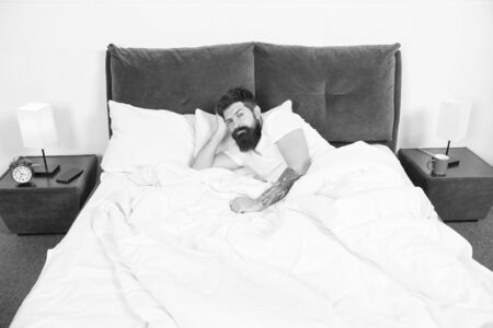 Insomnia. Sleep disorders concept. Man bearded hipster having problems with sleep. Guy lying in bed try to relax and fall asleep. Relaxation techniques. Violations of sleep and wakefulness Banque d'images - 131927977