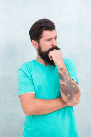 Extensive facial hair growth. Hipster with stylish beard and mustache hair. Bearded man with unshaven face hair. Brutal guy with shaped beard and styled hair. Hairdressing salon. Barbershop Фото со стока