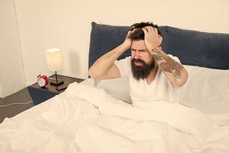 Time to relax. energy and tiredness. mature male with beard in pajama relax in bed. bearded man hipster sleep in morning. asleep and awake. brutal sleepy man in bedroom. just need more relax