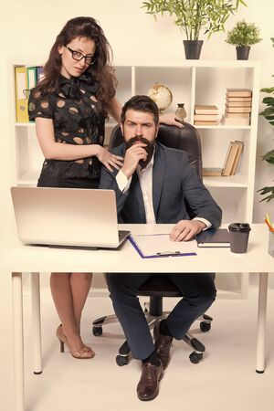 Running startup business together. Confident businessman and sexy woman working in startup company. Startup project managers in office. Co-founders of startup or start up