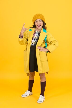 In rock style. Small girl gesture horn sign in formal style. Little cute child wear autumn fashion style. School dress code. School uniform never goes out of style
