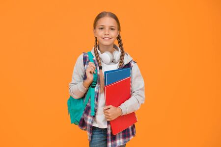 Modern education. Private schooling. Teen with backpack and books. Motivated and diligent. Stylish schoolgirl. Girl little fashionable schoolgirl carry backpack. Schoolgirl daily life. School club