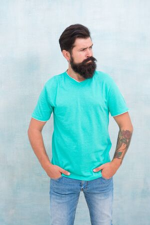 Pure brutal. Hipster wear long beard and mustache in brutal style. Bearded man with brutal look. Brutal caucasian guy isolated on white. Tattoo salon. Barbershop Stock Photo
