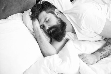 Sleep disorders concept. Man bearded hipster having problems with sleep. Guy lying in bed try to relax and fall asleep. Relaxation techniques. Violations of sleep and wakefulness. Need some rest Banque d'images - 131928224