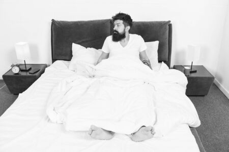 asleep and awake. Too early to wake up. bearded man hipster sleep in morning. mature male with beard in pajama on bed. brutal sleepy man in bedroom. energy and tiredness. Sleepy and handsome Banque d'images - 131928227