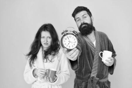 Its coffee time. Man with beard and sleepy woman enjoy morning coffee or tea. Guy in bath clothes hold tea coffee. Breakfast concept. Every morning begins with coffee. Couple in bathrobes with mugs