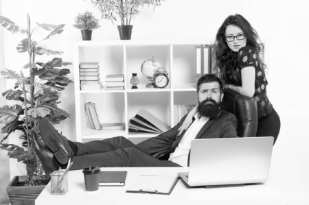 Modern business couple working office. Business people concept. Business couple in office. Man and attractive woman. Boss manager director and ceo position. Business man secretary. Job and career Stockfoto