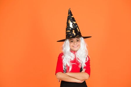 Magical spell. Small witch with white hair. Wizard or magician. Ghosts have real spirit. Little child witch costume. Halloween party. Small girl in black witch hat. Autumn holiday. Join celebration