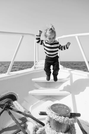Baby boy enjoy vacation sea cruise ship. Child sailor. Boy sailor travelling sea. Boy sailor striped shirt sea yacht travel around world. Little sea traveller. Collecting memories. Entertainment jobs