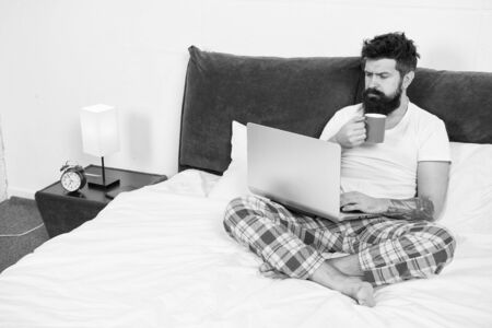 Sleeping at working place. asleep and awake. energy and tiredness. businessman with computer. bearded man hipster work on laptop. brutal sleepy man in bedroom. mature male drink coffee
