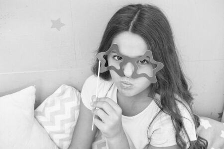 small girl party glasses. pajama party. ready for fun. funny look of small kid. childhood moments. international childrens day. serious child in star glasses. good morning. dont want to sleep