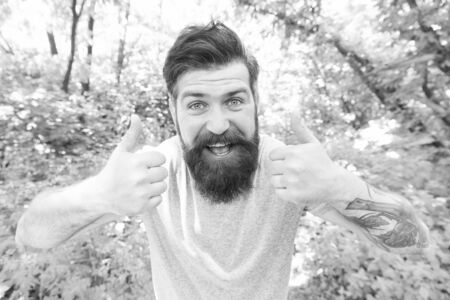 Summer fun. Bearded guy in park forest. Bearded hipster. Crazy bearded man in natural environment. Hipster with long beard emotional face close up nature background. Go wild. Hair care male beauty Zdjęcie Seryjne