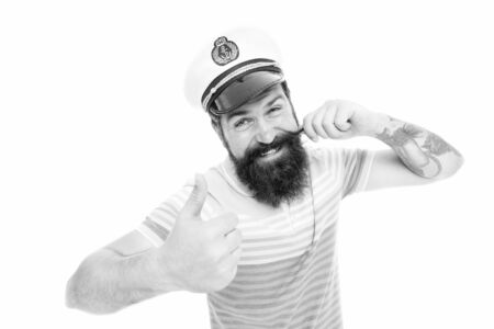 Captain of cruise liner. Brutal seaman isolated on white. Captain concept. Welcome aboard. Bearded man captain of ship. Sea cruise. Travel concept. Summer vacation. Hipster beard mustache sailor hat