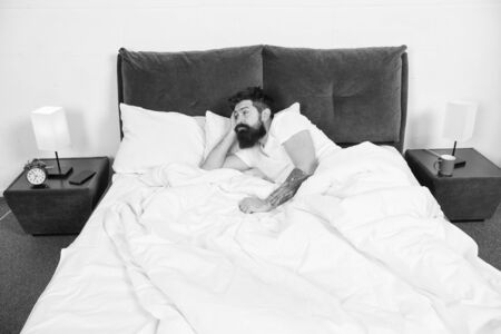 Sleep disorders concept. Man bearded hipster having problems with sleep. Guy lying in bed try to relax and fall asleep. Relaxation techniques. Violations of sleep and wakefulness. Insomnia