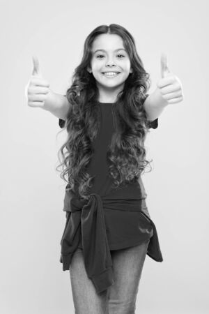 Perfect curls. Kid cute face with adorable curly hairstyle. Little girl grow long hair. Teen fashion model. Styling curly hair. Change you can see. Hairdresser tip. Kid girl long healthy shiny hair