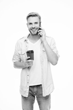 Positive morning. happy man speak on phone. morning coffee. smiling man drink coffee isolated on white. break for lunch in office. always online. really good news. order coffee delivery. coffee to go