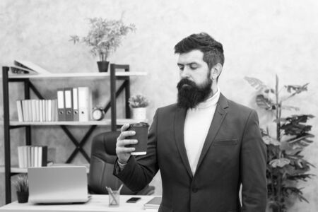 Man bearded manager businessman entrepreneur hold cup of coffee. Relaxed manager drinking coffee. Boss enjoying energy drink. Worker start day with hot coffee