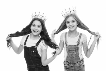 Adorable little princesses in crowns with long hair source of their pride. Cute small girls feeling great pride of their hairstyles. Pride and joy