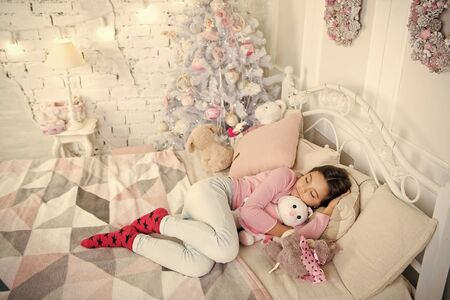 little child girl with xmas present. morning before Xmas. Sleep. happy new year. Christmas shopping. waiting for santa. Winter. small girl sleeping at home. christmas family holiday. Merry Christmas.