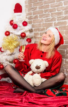 happy girl in santa claus hat. New year party. delivery christmas gifts. Smiling woman celebrating christmas. Merry christmas and happy new year. May all your days be happy and bright. Its yours