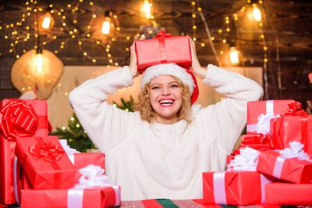 December happy moments. Gifts integral part of new year celebration. Intrigued concept. Festive mood. Beautiful wrapped gifts. Happy woman and bunch of gifts boxes. Girl ready for celebration
