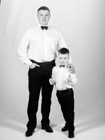 small boy with dad businessman. blue blood. family day. happy child with father. business meeting party. blue blood male fashion. parenting. fathers day. father and son in formal suit. tuxedo style