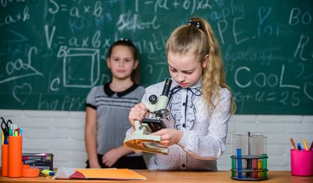 Girls study chemistry in school. Biology and chemistry lessons. Theory and practice. Observe chemical reactions. Formal education school. Educational experiment. Back to school. School classes