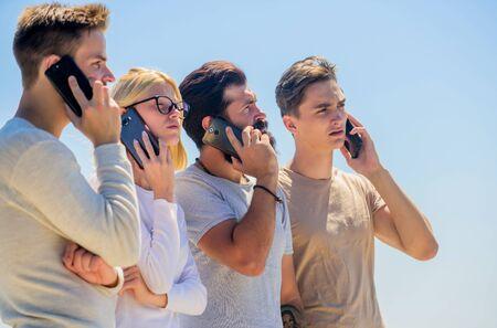 Men and girl speak on phone.