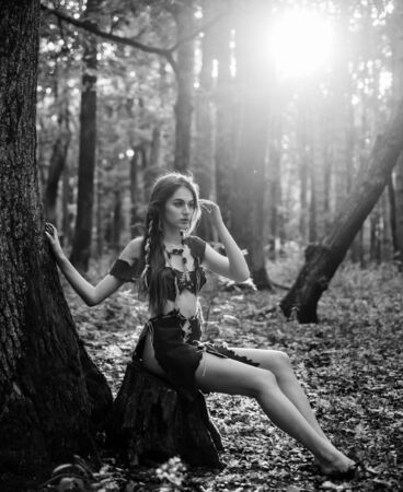 Female spirit mythology. She belongs tribe warrior women. Wild attractive woman in forest. Folklore character. Living wild life untouched nature. Sexy girl. Wild human. Wilderness of virgin woods Archivio Fotografico