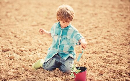 organic farm plantation. ecology life. eco farm. human and nature. earth day. Eco life. summer farm. happy child seeding on rich soil. Spring season. small kid planting a flower. This flower is yours.